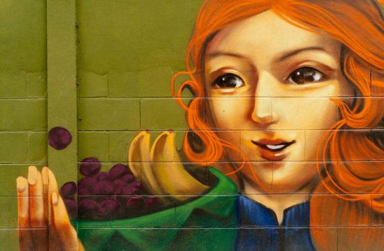 Wandmalerei einer rothaarigen Frau in der Altstadt von Chiang Mai